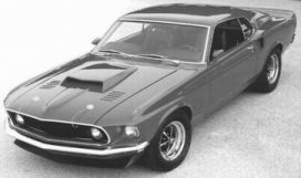 1969 Ford Mustang Mach 1 with front spoiler, 429 Boss hood scoop, hood louvers, and enhanced rear spoiler.